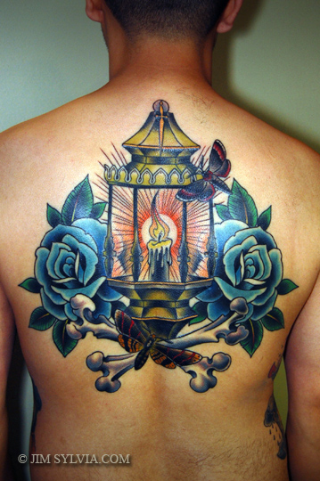 Candle Lamp With Blue Roses Tattoo On Upper Back
