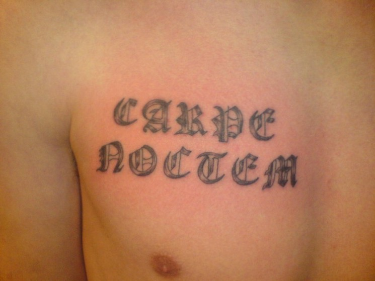 Carpe Noctem Ambigram Tattoo On Chest