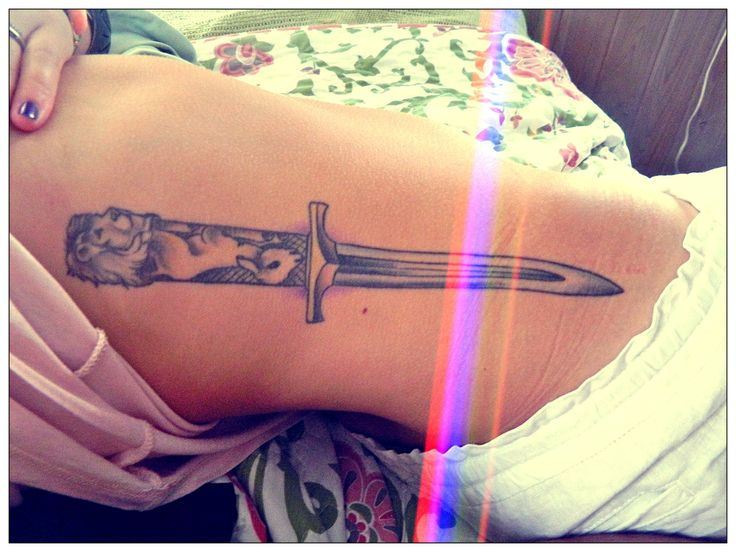 Cat With Sword And Lamp Tattoo On Ribs