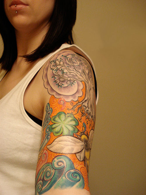 Charming Waves And Rose Tattoos On Arm