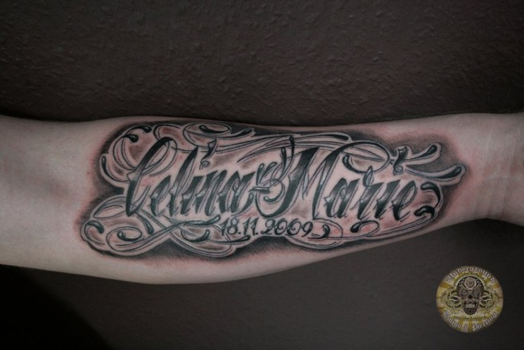 Chicano Calina Marie Lettering Tattoo On Arm
