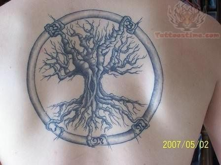 Circle Ambigram Tattoo On Upper Back