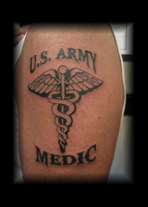 Claims Medic Military Tattoo On Lower Back