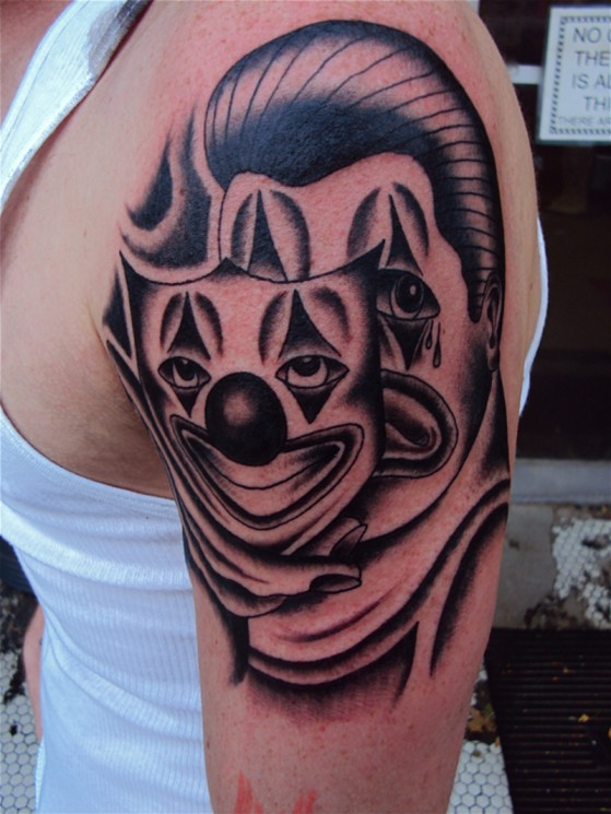 Clown Mask With Cigar Tattoo On Shoulder
