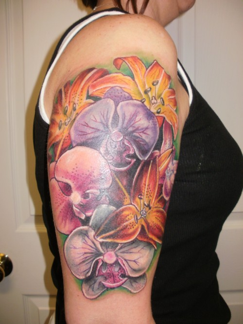 Color Ink Hibiscus Flowers Tattoo On Biceps
