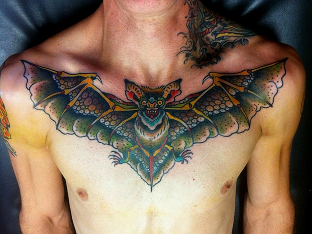 Colorful Bat Tattoo On Chest