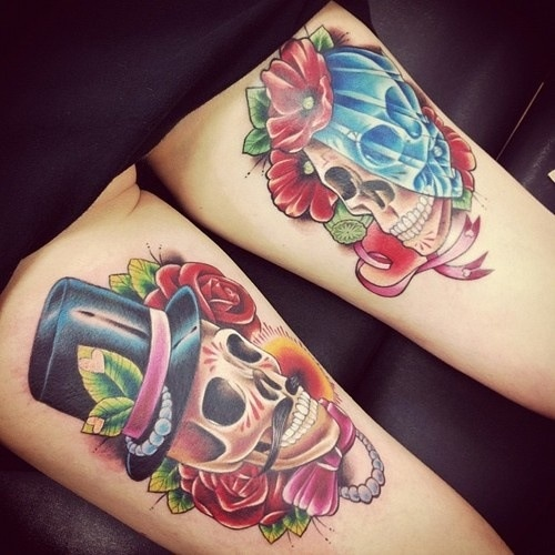 Couple Of Red Rose And Winged Skull Tattoos