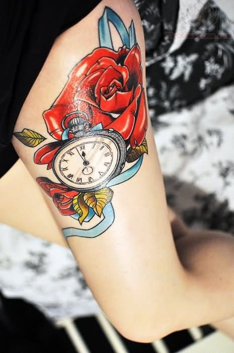 Couple Of Red Roses And Watch Tattoos On Thigh
