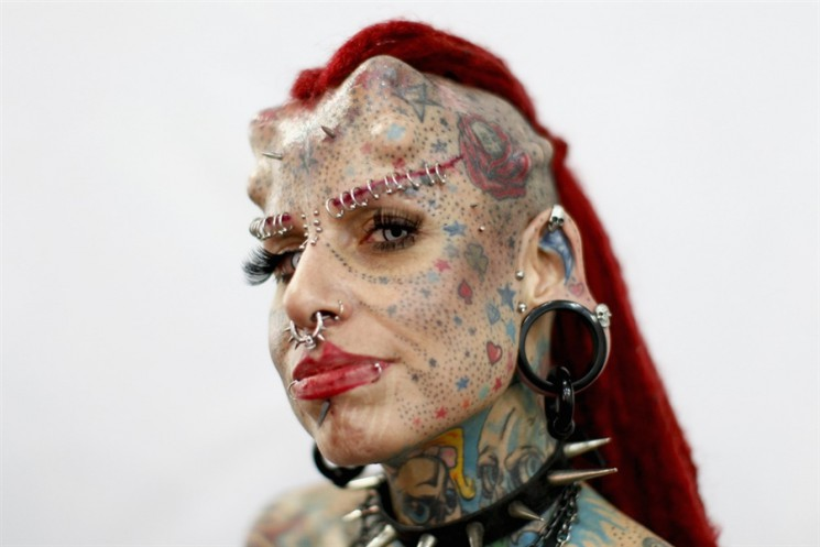 Crazy Guy With Extreme Full Face Tattoo Design