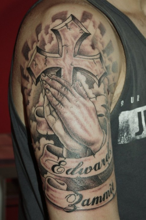 Cross Behind Praying Hands Tattoo