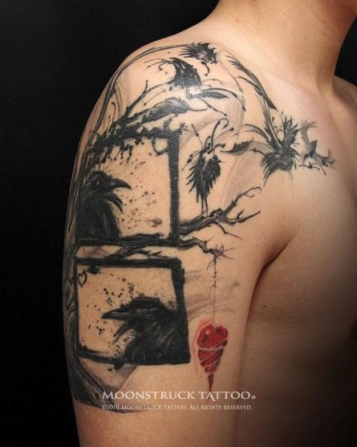 Crow Tree With Hanging Heart Tattoo On Upper Arm
