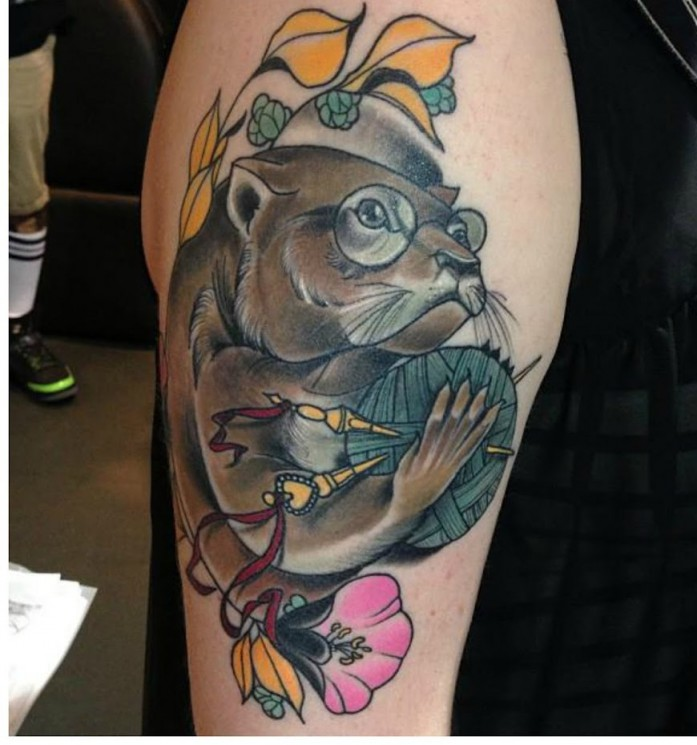 Cute Animal Tattoo On Biceps For Guys
