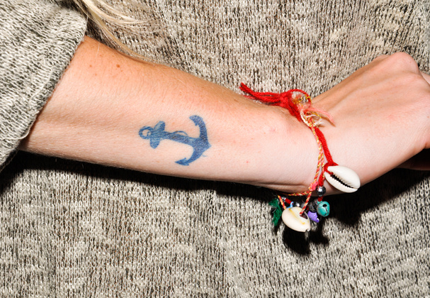 Cute Blue Ink Anchor Tattoo On Arm