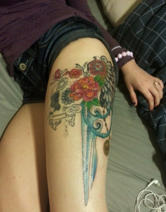 Dagger And Flowers Tattoos On Thigh