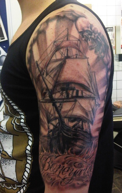 Dark Ship And Skull Tattoos On Sleeve