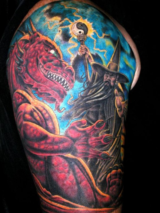 Dragon And A Wizard Tattoo On Arm