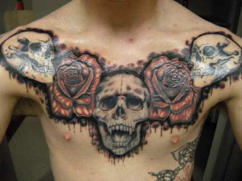 Dragon With Guns Tattoo On Chest