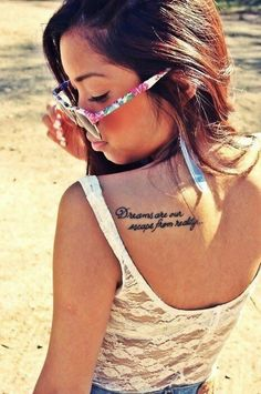 Dreams Are Our Escape From Reality Literary Tattoo On Back Shoulder