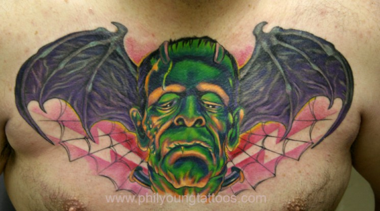 Evil Face Bat Wings Tattoo On Chest