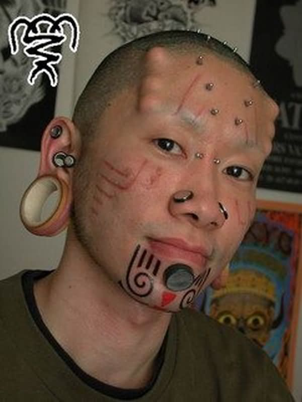 All Images To Extreme Piercing N Tattoo On Face