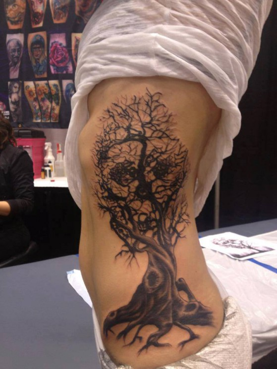 Face Illusion In Old Tree Tattoo On Side Body