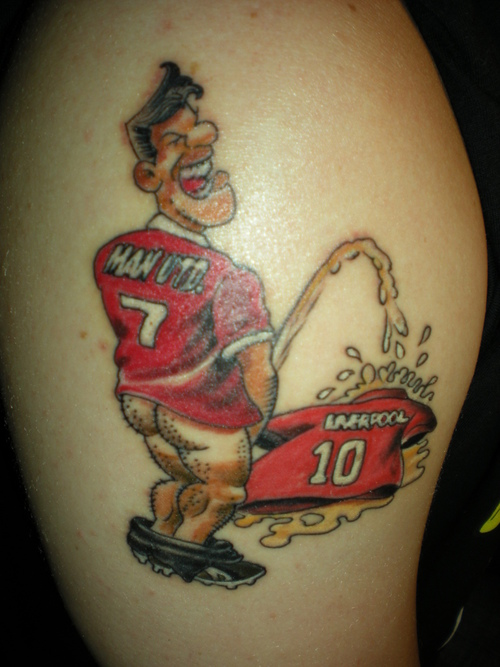 Fans Of Manchester United Sporting A Tattoo