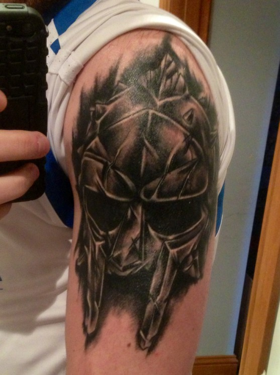Fantastic Helmet With Hairs Tattoo On Chest
