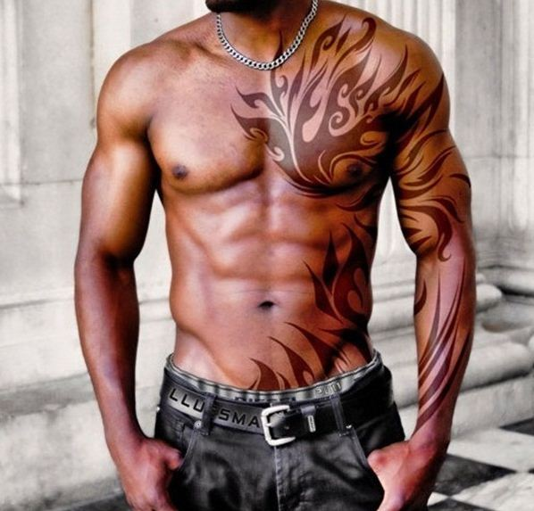 Fantastic Tribal Tattoos On Chest Rib Side And Muscles