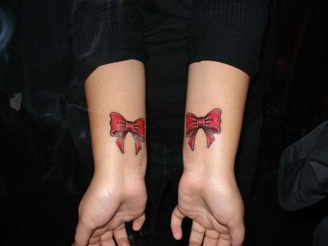 Feminine Bow Tattoo On Upper Back