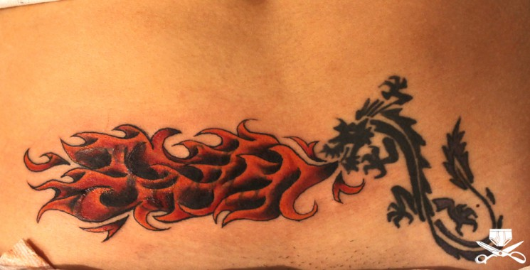 Fire nd Flame Tattoo On Lower Belly