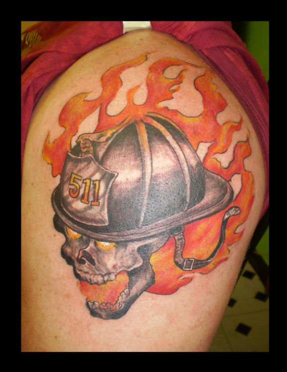 Flames And Firefighters Helmet Tattoo On Biceps