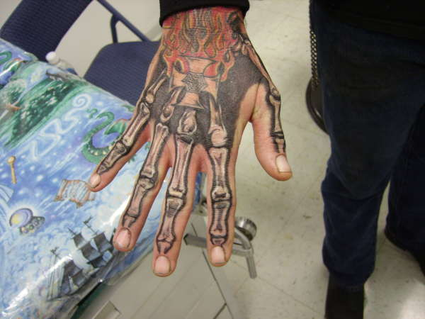 Flames And Skeleton Hand Tattoos