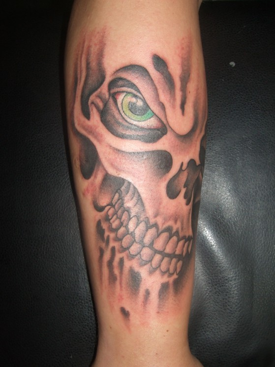 Flames And Skull Tattoos On Arm