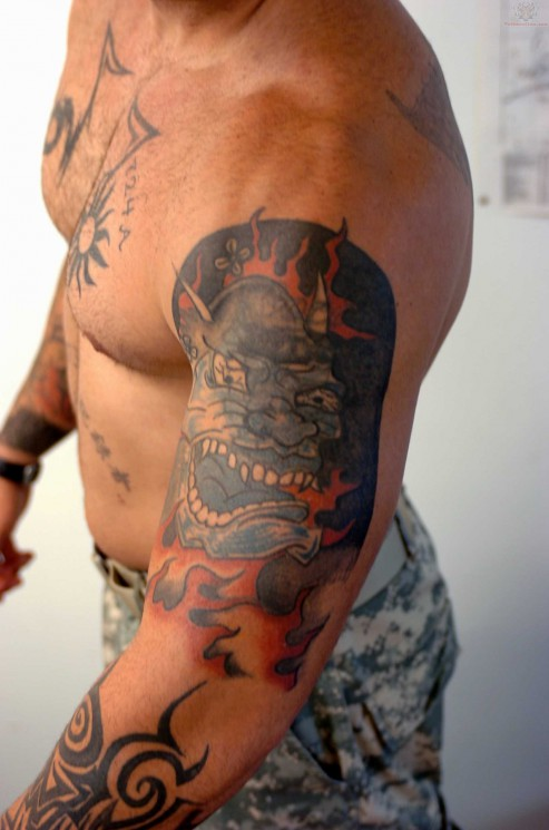 Flaming Demon Face Tattoo On Biceps
