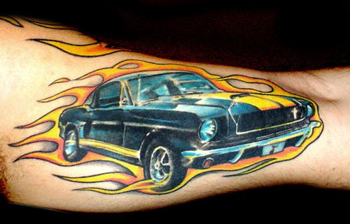 Flaming Wicked Car Tattoo On Muscles