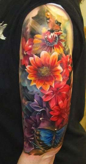 Flower And Leaves Sleeve Tattoo Design For Girls