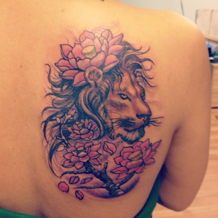 Flowers And Lion Tattoos On Thigh