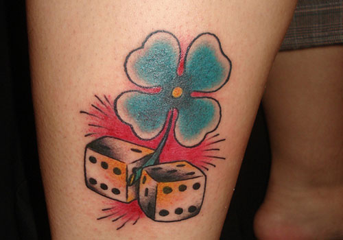 Four Leaf Clover And Dice Pair Tattoo Designs On Arm