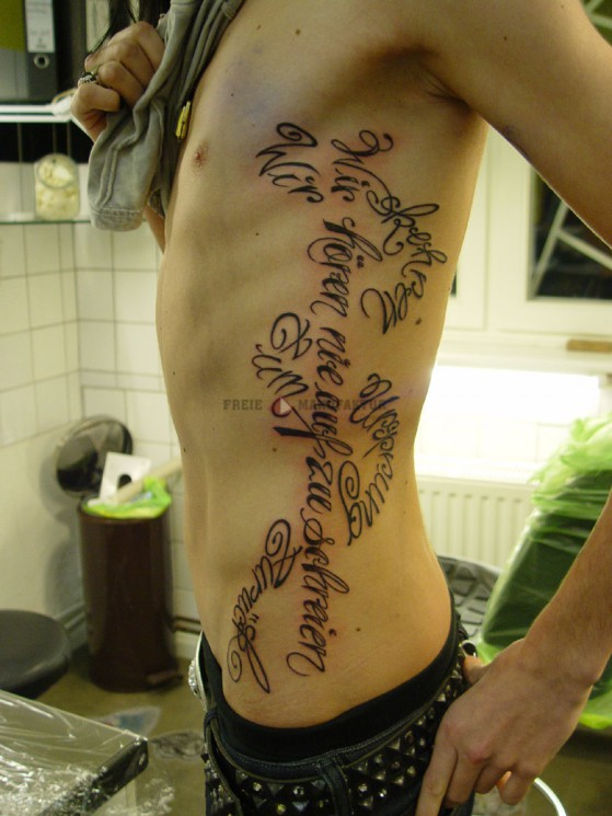 Fabulous Music Tattoos On Side Of Stomach