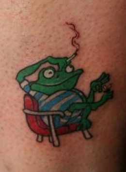 Frog Sitting On Chair Tattoo Design