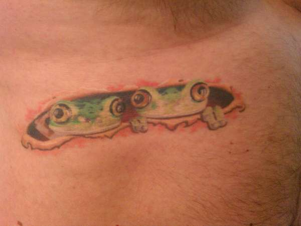 Frogs Peering Out Beneath Torn Skin Tattoo