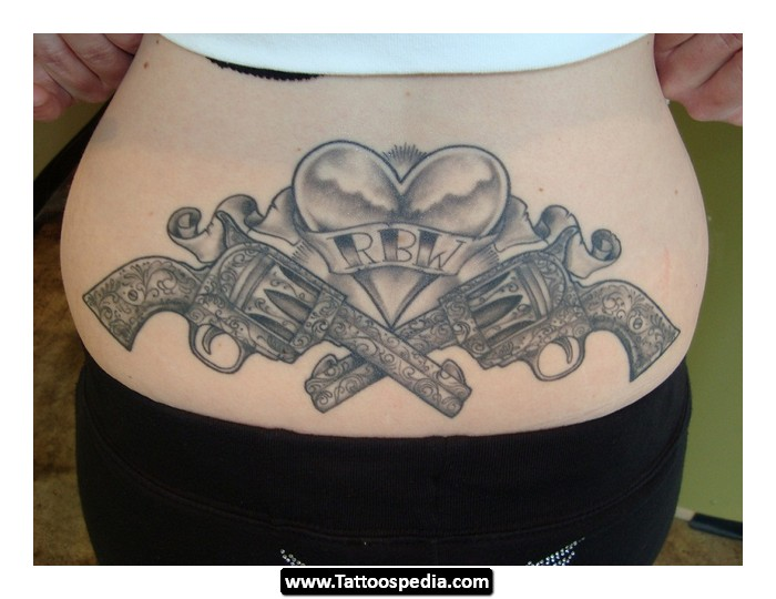 Girl With Crown Tattoo On Lower Back