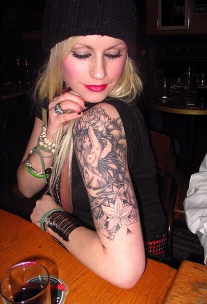 Girl With Feather Tattoo On Her Arm