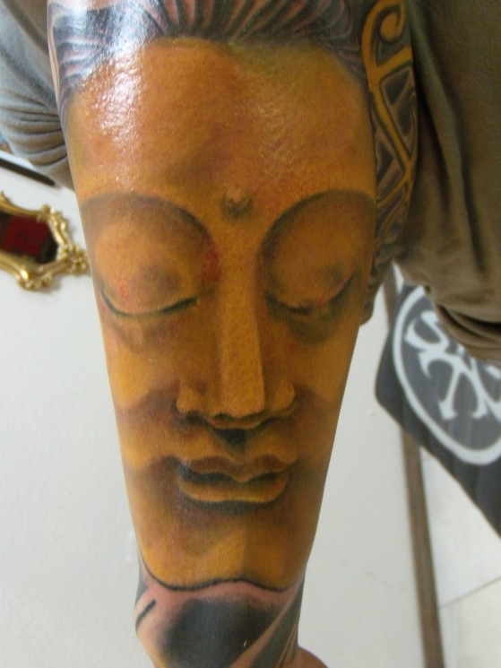 Golden Buddha Head Tattoo