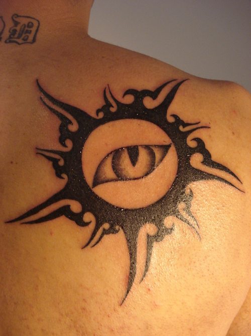 Gorgeous Tribal Sun Tattoo On Back Shoulder