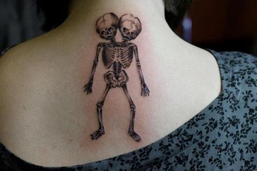 Grey Ink Branched Skeleton Tattoo