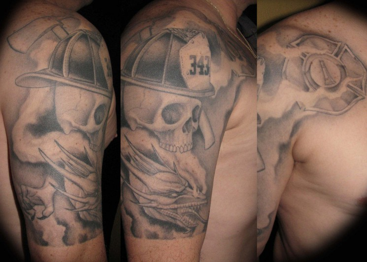 Grey Ink Firefighter Head And Helmet Tattoo On Shoulder