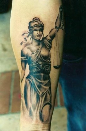 Grey Ink Lady Justice Tattoo On Arm