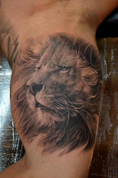 Grey Ink Lion Face Tattoo On Biceps