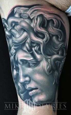 Grey Ink Medusa Head Tattoo